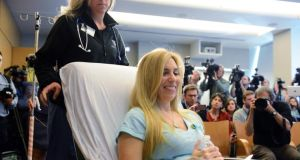 Boston Marathon bombing victim Heather Abbott of Newport. Rhode Island is wheeled into a press conference at Brigham and Women's Hospital. Photograph: Darren McCollester/Getty Images