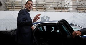 Spain's prime minister Mariano Rajoy waves as he gets into his car after attending the weekly government's control session at the parliament in Madrid. Photograph: Sergio Perez/Reuters