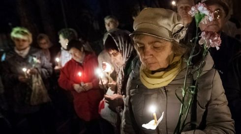Women hold flowers and candles for victims of the Chernobyl nuclear disaster during a memorial service in Kiev, Ukraine, on the 27th anniversary of the event. Photograph: Sergii Polezhaka/Reuters
