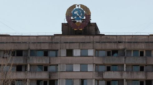 The coat of arms of the former Soviet Union on the roof of a house in the abandoned city of Pripyat a few days before the Chernobyl anniversary. Photograph: Gleb Garanich/Reuters