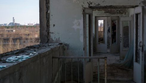 The Chernobyl plant in the background from the vantage point of a delapidated apartment building, days before the 27th anniversary. Photograph: Gleb Garanich/Reuters