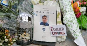 A makeshift memorial for Massachusetts Institute of Technology police officer Sean Collier, who was killed during an encounter with Boston Marathon bombings suspects, in Cambridge. Photograph: Katherine Taylor/The New York Times
