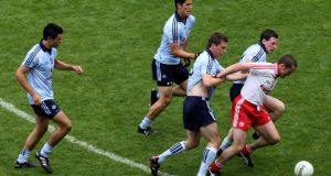 Dublin defenders Cian O'Sullivan, Rory O'Carroll, Kevin Nolan and Philip Fitzsimons close in on Stephen O'Neill during the All-Ireland senior quarter final in 2010. Photo: Inpho