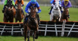 Ruby Walsh riding Hurricane Fly clear the last to win The Rabobank Champion Hurdle at Punchestown. Photograph: Alan Crowhurst/Getty Images