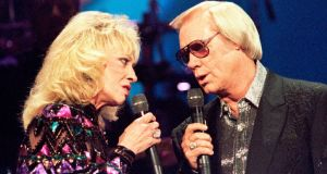 Country singer George Jones with the late Tammy Wynette at the Country Music Association Awards in Nashville, Tennessee in in 1995. Photograph: Jeff Mitchell/Reuters