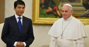 Pope Francis stands with Andry Nirina Rajoelina, president of Madagascar, during their private audience in the Vatican yesterday. Photograph: Vincenzo Pinto/Reuters