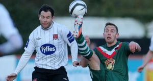 Dundalk's Mark Rossiter and Danny Furlong of Cork City. Photograph: Cathal Noonan/Inpho