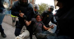 A protester is detained by Spanish riot police during a planned demonstration against the government in Madrid. Photograph: Sergio Perez/Reuters
