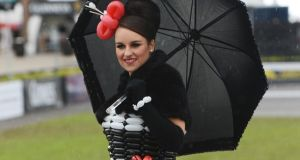 Laura Whitty, from Gorey, Co Wexford, wearing a balloon dress made by her brother Niall, at Punchestown races yesterday. Photograph: Cyril Byrne