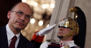 Italian prime minister-designate and deputy leader of the centre-left Democratic Party (PD) Enrico Letta arrives to speak with reporters at the Quirinale Palace. Photograph: Alessandro Bianchi/Reuters