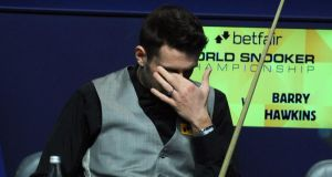 Mark Selby sits dejected in his chair as he loses his second round match against Barry Hawkins at the Betfair World Championships at the Crucible, Sheffield. Photograph:  Anna Gowthorpe/PA