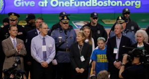 Members of the community, who assisted in the aftermath of the Boston Marathon bombings, are honoured  during a break in play between the Boston Celtics and New York Knicks in the first half of Game 3 of their NBA Eastern Conference semi-final play-off  in Boston. Jessica Rinaldi/Reuters
