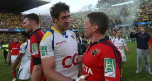 Nathan Hines and  Ronan O'Gara at the end of the Heineken Cup semi-final. Photograph: Billy Stickland/Inpho