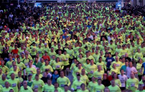 Over 7,000 runners took to the traffic-less streets of Dublin for the Samsung Run Dublin at Night 10K. The race began on Westmoreland street. Photograph: INPHO/Ryan Byrne
