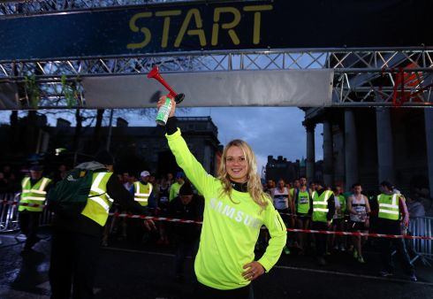 Over 7,000 runners too to the traffic-less streets of Dublin for the Samsung Run Dublin at Night 10K. Ailis McSweeney starts the race. Photograph: INPHO/Lorraine O'Sullivan