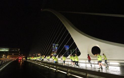 Over 7,000 runners took to the traffic-less streets of Dublin for the Samsung Run Dublin at Night 10K. Runners cross the Samuel Beckett Bridge. Photograph: INPHO/Lorraine O'Sullivan