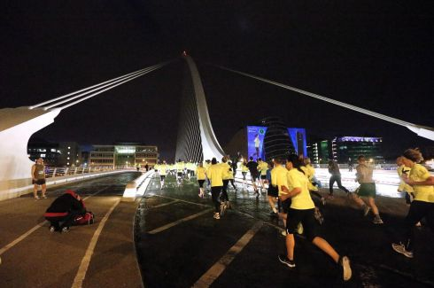 Runners cross the Samuel Beckett Bridge. Photograph: INPHO/Lorraine O'Sullivan