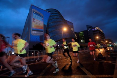 Runners make their way past the Convention Centre. Photograph: INPHO/James Crombie