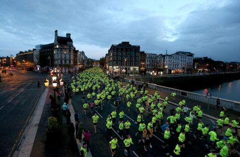 Over 7,000 runners took to the traffic-less streets of Dublin for the Samsung Run Dublin at Night 10K. Runners make their way across O'Connell bridge. Photograph: INPHO/Ryan Byrne