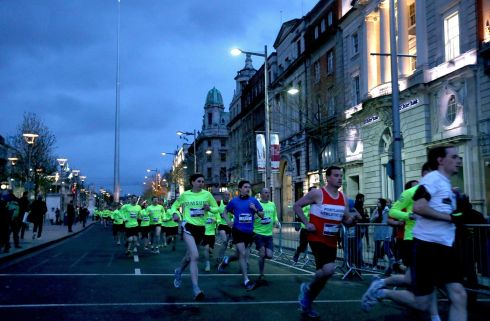 Over 7,000 runners took to the traffic-less streets of Dublin for the Samsung Run Dublin at Night 10k on April 28th.  Runners make their way down O'Connell street Photograph: INPHO/Ryan Byrne