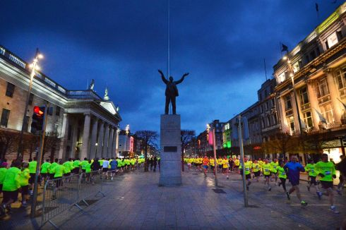 The statue of Jim Larkin presides over O'Connell Street as runners make their way through traffic free streets. Photograph: Alan Betson /The Irish Times