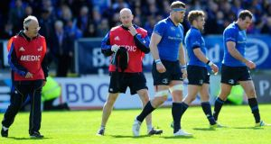 Jamie Heaslip leaves the field with a leg wound during the Amlin Challenge Cup semi-final match between Leinster and Biarritz  at the RDS.  Photograph: Stu Forster/Getty Images