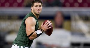 Quarterback Tim Tebow has been let go by the New York Jets. Photograph:   David Welker/Getty Images