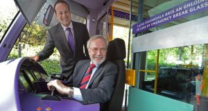 Minister for Transport, Tourism and Sport Leo Varadkar and European Investment Bank president Werner Hoyer at the controls of a Luas tram at St Stephen's Green, Dublin, yesterday, following discussions on future investment in the Luas network. Photograph: Eric Luke