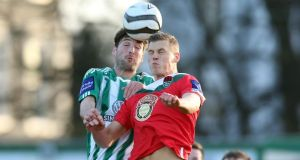 Bray Wanderer's David Webster challenges  Ian Turner of Cork during their Premier League clash at the Carlisle Grounds. Photograph:  Donall Farmer/Inpho