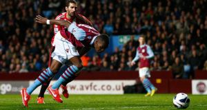 Aston Villa's Christian Benteke  heads  his second goal  against Sunderland during their  Premier League game at Villa Park. Photograph: Darren Staples/Reuters
