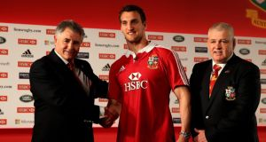 Lions captain Sam Warburton (centre)  shakes hands with tour manager Andy Irvine (left) and head coach Warren Gatland today.   Photograph: Paul Gilham/Getty Images for HSBC