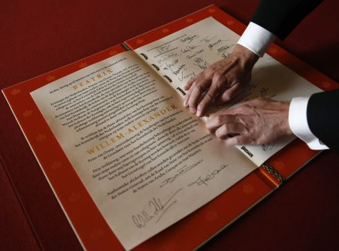 The Act of Abdication signed by Queen Beatrix in the Moseszaal at the Royal Palace. Photograph: Jerry Lampen/Pool/Getty Images