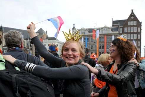 Revellers in Dam Square celebrate the day. Photograph: Laurent Dubrule/Reuters