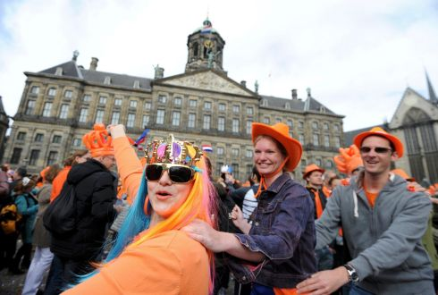 Colourful celebrations at Amsterdam's Dam Square following the ceremony today. Photograph: Laurent Dubrule/Reuters