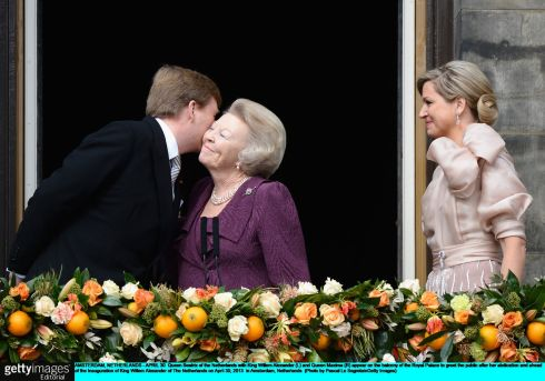 AMSTERDAM, NETHERLANDS - APRIL 30:  Queen Beatrix of the Netherlands with King Willem Alexander (L) and Queen Maxima (R) appear on the balcony of the Royal Palace to greet the public after her abdication and ahead of the Inauguration of King Willem Alexander of The Netherlands on April 30, 2013  in Amsterdam, Netherlands.  (Photo by Pascal Le Segretain/Getty Images)