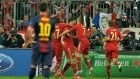 Barcelona's Lionel Messi looks on as Bayern players celebrate after Mario Gomez, third right, scored during the Champions League semif-final first leg at the Allianz Arena. (Photo: Kerstin Joensson/AP)