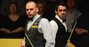 Stuart Bingham and Ronnie O'Sullivan during yesterday's action at the World Snooker Championship at the Crucible Theatre, Sheffield. Photograph: Getty Images