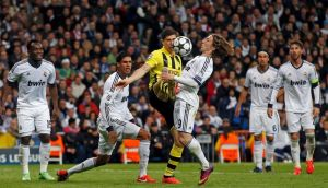 Borussia Dortmund's Robert Lewandowski is challenged by Real Madrid's Luka Modric as team-mates Raphael Varane, Karim Benzema, Sami Khedira and Sergio Ramos look on during their Champions League semi-final second leg soccer match at the Santiago Bernabeu in Madrid. Photograph: Juan Medina/Reuters