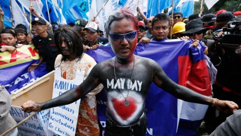 A May Day demonstrator in bodypaint leads a group of union members and activists in a demonstartion in front of the presidential palace today in Jakarta, Indonesia. Photograph: Getty Images