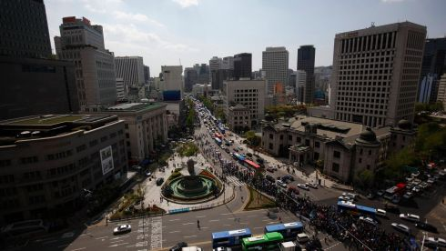 Workers from the Korean Confederation of Trade Unions (KCTU) march during a May Day rally in central Seoul today. Photograph: Reuters