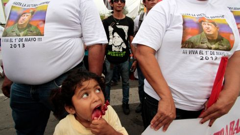 A child looks at supporters of the ruling People wear t-shirts with an image of late Venezuela's president Hugo Chavez during May Day celebrations in Managua today. Photograph: Reuters