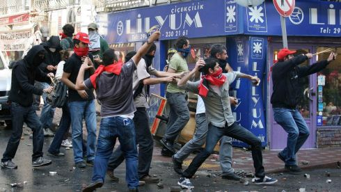 May Day protesters throw stones at riot police as they try to break through barricades to reach the city's main square in central Istanbul today.  The incidents followed the pattern of recent years, when May Day demonstrations in Turkey's largest city have often been marked by clashes between police and protesters. Photograph: Reuters