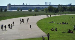 People enjoy the sun on the tarmac of former Tempelhof Airport. Photograph: Johannes Eisele/AFP/Getty Images