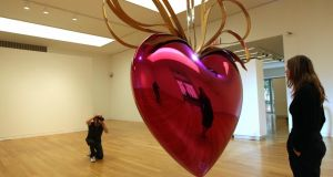 Art or kitsch?: Jeff Koons's Hanging Heart in magenta and gold. Photograph: Emmanuel Dunand/AFP/Getty