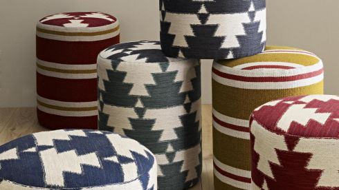 THREE OF THE BEST: TRIBAL BEATS  Give accent furniture a pattern make-over with Osborne and Little's (osborneandlittle.com) Ikat-inspired Mohawk, patterened with interlocking Indian pyramids in a heavily textured cotton and linen (€114 per metre). The klilm-inspired Kiowa pattern of horizontal stripes in a wool combination costs €87 per metre. They look especially striking in the cylindrical stools pictured. Stockists include Brian S Nolan (01-2800564 briansnolan.ie) in Dun Laoghaire.