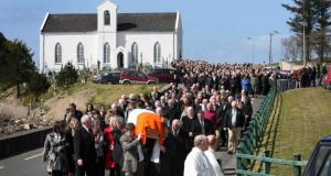 The remains of the late Harry Blaney are carried by his sons Niall and Liam from St Columba's Church, Fanad, Co Donegal yesterday.