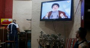 The TV In a coffee shop in Beirut shows Hizbullah leader Sayyad Hassan Nasrallah speaking on television yesterday. Photograph: Mohamed Azakir/Reuters