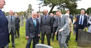 Prince Edward, Duke of Kent (centre), with Jimmy Deenihan (left) and Shane Mac Thomais at a grave in Glasnevin cemetery. Photograph: Alan Betson