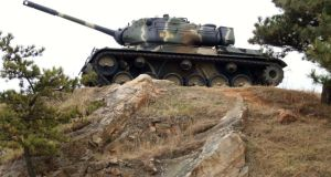 A South Korean tank overlooks the summit of Baengyeong Island. Photograph: Tom Farrell