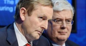 Taoiseach Enda Kenny and Tánaiste Eamon Gilmore at a media briefing at Government Buildings yesterday. Photograph: Alan Betson/The Irish Times